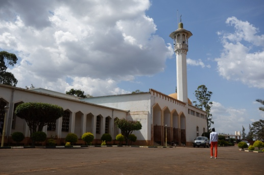 A boy is heading for the entrance of a mosque with adjoining school in Kigali.
