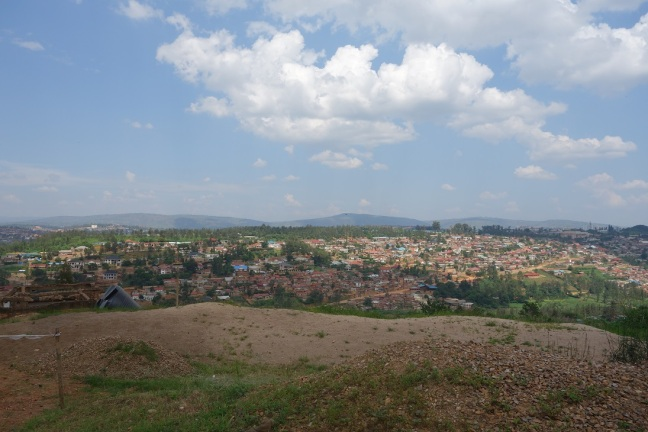 View over the houses on the outskirts of Rwanda's capital Kigali. In the background are some of the many Rwandan hills.