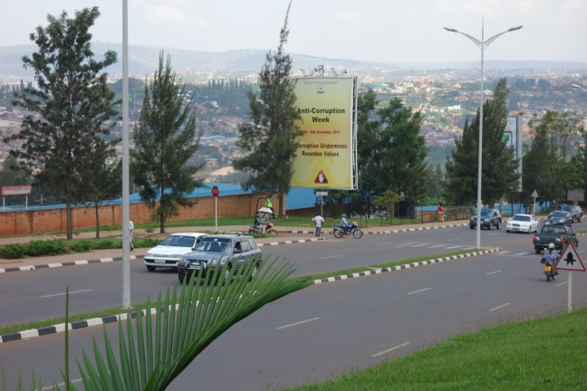 Cars and motorcycle taxis on a main road in Kigali