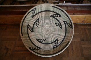 A round and flat traditional Rwandan basket